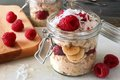 Breakfast overnight oats with fresh raspberries in a jar Royalty Free Stock Photo