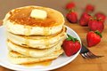 Breakfast pancakes stack of with syrup and strawberries Royalty Free Stock Image