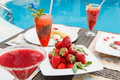 Breakfast by the pool light snacks fresh strawberries fruit smoothies Stock Photography