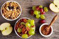 Breakfast prep with toasted oat clusters, juicy raisins, banana and pineapple chunks  grapes  pecan nut. Royalty Free Stock Photo