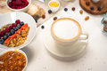 Breakfast quinoa porridge with fresh fruits in a bowl healthy breakfast background with coffee, berries, egg, nuts Royalty Free Stock Photo