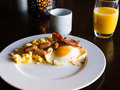 Breakfast at a restaurant plate with eggs and sausages Stock Photo