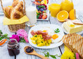 Breakfast rich on wooden background Royalty Free Stock Photos