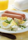 Breakfast with sausage and boiled eggs Royalty Free Stock Photo
