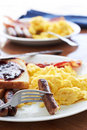 Breakfast with sausage links and scrambled eggs. Royalty Free Stock Photo
