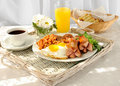 Breakfast with scrambled eggs and bacon Stock Image
