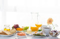 Breakfast served in front of the window Royalty Free Stock Photo