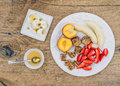 Breakfast set with fresh strawberry, banana, peach, dry figs, wa Royalty Free Stock Photo