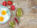 Breakfast set with fried egg on a wooden desk country and cherry tomatoes Stock Photography