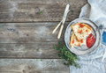 Breakfast set. Thin crepes with red caviar on rustic metal plate, fresh thyme and vintage dinnerware over a rough wood background. Royalty Free Stock Photo