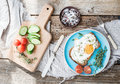 Breakfast set. Whole grain sandwich with fried egg, vegetables and herbs Royalty Free Stock Photo