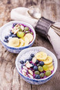 Breakfast smoothie bowl with fruits and granola Royalty Free Stock Photo