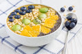 Breakfast smoothie bowl topped with berries, fruits, nuts and seeds Royalty Free Stock Photo