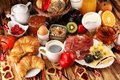 Breakfast on table with bread buns, croissants, coffe and juice on valentines day Royalty Free Stock Photo