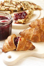 Breakfast table with croissant and pancakes jam Stock Photography