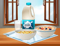 Breakfast on table with milk and cereal Royalty Free Stock Photo