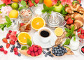 Breakfast table setting with coffee, croissants, granola. Health Royalty Free Stock Photo