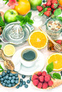 Breakfast table setting with coffee, croissants, granola, honey. Royalty Free Stock Photo
