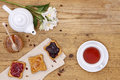 Breakfast table with tea teapot cup of tea jam honey bread and Royalty Free Stock Image