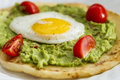 Breakfast tasty guacamole and fried eggs Royalty Free Stock Photography