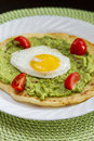 Breakfast tasty guacamole and fried eggs Stock Photo
