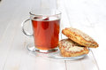 Breakfast tea and biscuits on the kitchen table selective focus Stock Images