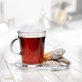 Breakfast tea and biscuits on the kitchen table selective focus Royalty Free Stock Photography