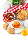 Breakfast with tea and fresh cookies on white background Royalty Free Stock Photos