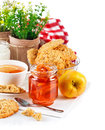 Breakfast with tea jam and fresh cookies on white background Stock Photo