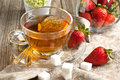Breakfast with tea and strawberries Stock Images