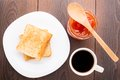 Breakfast with tea toast and apricot jam black Stock Images