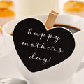 breakfast and text happy mothers day in a heart-shaped blackboard