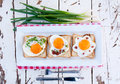 Breakfast three fried eggs on toast bread shoot from above Stock Photos