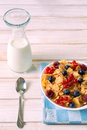 Breakfast time cereal with berry fruit in the bowl from above on wooden table Royalty Free Stock Photo