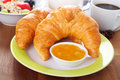 Breakfast time croissants with jam cereals and coffee Stock Photography
