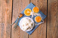 Breakfast time homemade yogurt cottage cheese orange jam assortment of products on a wooden table top view selective focus Royalty Free Stock Images