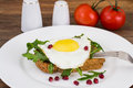 Breakfast toast with fried egg and arugula Royalty Free Stock Photo