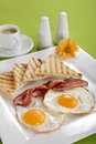 Breakfast - toasts, eggs, bacon Royalty Free Stock Photography