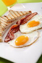 Breakfast - toasts, eggs, bacon Stock Photo
