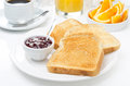 Breakfast with toasts jam coffee and orange juice closeup Royalty Free Stock Photo
