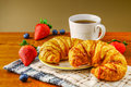 breakfast with two croissants coffee and berries Royalty Free Stock Photo