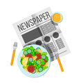 Breakfast vegetable salad and orange juice top view. Newspaper o Royalty Free Stock Photo