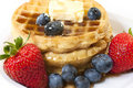 Breakfast with Waffles and Fruit Closeup Stock Photos