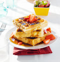 Breakfast - waffles with syrup and strawberries Stock Photos