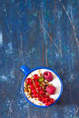 Breakfast yogurt witn granola and fresh berries on an old wooden board Royalty Free Stock Photography