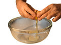 Breaking egg into bowl
