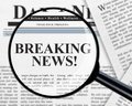 Breaking news headline under magnifying glass Royalty Free Stock Photo