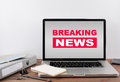 Breaking News. Office desk with a laptop. Royalty Free Stock Photo