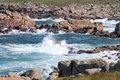 Breaking waves crashing into granite rocks. Stock Photography