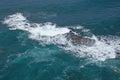 Breaking waves at rocky coast Royalty Free Stock Photo